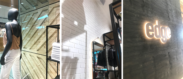 Light-coloured timbers and smooth black metal set off the white Dura Tumbled brick from DuraBric – Edge Clothing fit out, Melbourne