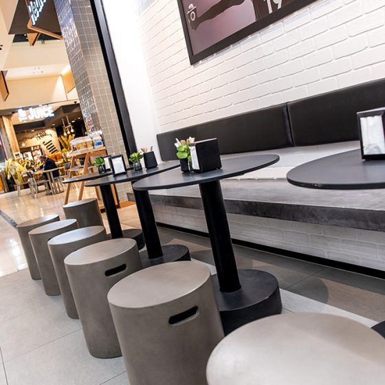 Dura Tumbled brick profile from DuraBric, applied to retail fit-out and painted – Acai Brothers Super Food Bar, Canberra